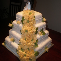 Yellow Wedding Cake Done for a wedding last month. Top and 3rd tiers are spice cake, 2nd and 4th are vanilla.