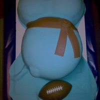 Baby Bump The baby shower was football themed. Check out the baby's foot kicking the ball. the football is chocolate.