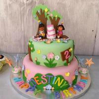Dora Cake Vanilla cake covered in fondant with gumpaste accents.