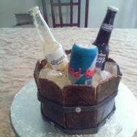 Ice Bucket Cake With Bottles  Sorry, my camera phone was not good this day. I made this for my brothers birthday. Edible ice and bottles. wooden panels made from 50/50...