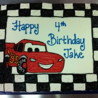 Lightning Mcqueen Cars Cake   1/2 sheet vanilla chiffon with lightning mcqueen from the movie Cars piped on freehand with SMBC. TFL