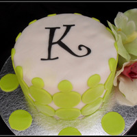 Lime Green Polka Dot Cake Chai Spice and Chocolate Cake with White Chocolate Buttercream and Marshmellow fondant. Polka Dots are fondant and flowers are artificial...