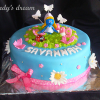 Smurfette Vanilla cake, BC, Fondant. Smurfette is a toy and Ladybird a choclate, rest fondant. Thanks for looking.