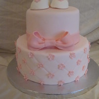Baby Shower Baby shower cake for a baby girl with little gumpaste baby shoes.