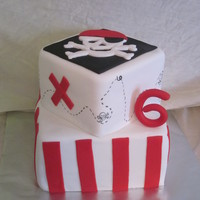 Pirate Themed Cake Client wanted a pirate themed cake and so I went with it, inspired by a couple different cakes that I saw on google images.