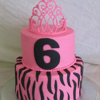 6Th Birthday Cake Cake is iced in buttercream with Fondant decorations and a royal icing tiara.