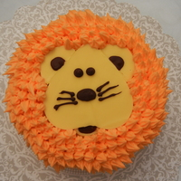 Lion Birthday Cake   6 inch petal pan for smash cake. The face is made from candy melts.