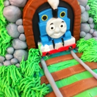 Thomas The Train Birthday Cake Decorated the whole thing around her candle she bought. It was fun :) My son loved it and got to go to the party too! Decorations were MMF...