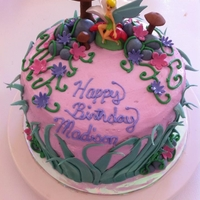 Fairy Cake Decorated this cake around the candle she bought. Garden Fairy Theme, everything was MMF or buttercream