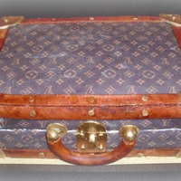 Louis Vuitton Vintage Luggage Vanilla cake with chocolate Italian meringue buttercream filling and frosting. Coverred in fondant and edible images used for the print....