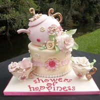 "Tea Party Cake Everything is edible. Bottom cake is made of 2 8"" rounds and a 7"" round in the middle to give it a tapered shape. Tea pot cake is..."