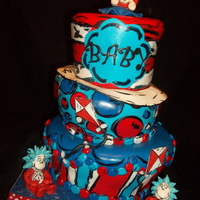 Dr. Suess Thing 3  THING 3 theme for a 3rd baby. Bottom tier and hat are strawberry cake with lemon curd filling and lemon Italian Meringue buttercream....