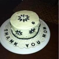 "Thanks Mom ""thanks Mom"" cake is chocolate 6' cake with vanilla buttercream and black fondant accents"