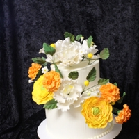2Nd Anniversary Cake This is a small 2 tier anniversary cake decorated with hand made gumpaste flowers & foliage.