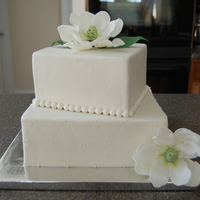 Magnolia Wedding Cake Chocolate and Red Velvet cakes covered in fondant. My 1st wedding cake :)