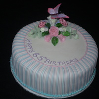 Candy Stripe   White fondant covered cake with gumpaste flowers and butterfly