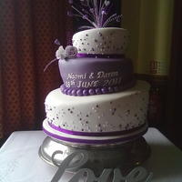 Topsy Turvey Wedding Cake   Bottom Tier Victoria sponge, middle tier Chocolate, toptier fruit covered in fondant. Purple is spray painted