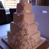Roses Ivory Roses on a 4 tier square cake, wish had got a better pic!
