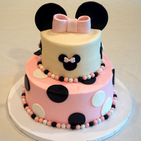 Minnie Mouse Themed Cake And Cupcakes This was inspired by several versions of this type of cake here on CC and on several other sites that my client sent to me. This was for...