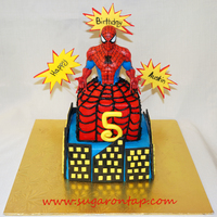 Spiderman Cake  VBC over chocolate cake. Fondant accents. Spiderman upper body is actually a plastic piggy bank I found at my local Target and decided to...