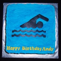 Swimmer Black fondant silhouette on buttercream.