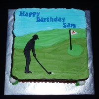 Golfing Black fondant silhouette on buttercream.