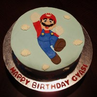 Super Mario Super Mario was made by tracing design on fondant and piecing together like a puzzle.