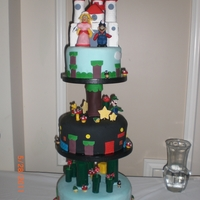 Super Mario & Princess Peach Grooms Cake Three tier vanilla chambord buttercream. Princess Peach marrying Super Mario as topper. All edible characters.