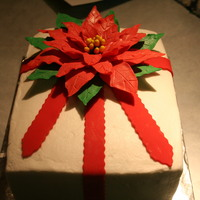 Christmas Package, Poinsettia This is a cake I made to take to work. It is chocolate cake with buttercream icing and filling. The pointsettia is made of gumpaste and...