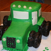 Tractor Cake This is a tractor cake I made for my grandson's birthday. The tractor is all cake, the wheels are cruller donuts covered in chocolate...
