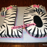16Th Birthday Cake White 1 And Chocolate 6 Cakes With Modeling Chocolatefondant Zebra Pattern Fondant Bows 16th Birthday cake. White (1) and Chocolate (6) cakes with modeling chocolate/fondant zebra pattern. Fondant bows.