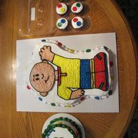 Caillou Cake Caillou cake was carved out of a half sheet looking at a bob the builder pan. small smash cake and cupcakes to match