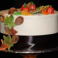 Fall Wedding Triple chocolate cake, iced and filled with buttercream. Fondant leaves and mallow pumpkins with luster dust.