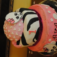 "Pink & Black Baby Skull First birthday party cake. ""Bandana"" top covered in mm fondant, gumpaste skulls, etc. Not so good with the bottom tier, but my..."