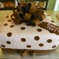 Gift Box Yellow CME with chocolate buttercream and MMF. Chocolate fondant bow and accents.