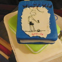 Book Cake Stacked books for my daughter's reading party at school. Yellow CME with vanilla buttercream and MMF. Picture drawn with edible...