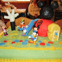 Mickey Mouse Clubhouse Buttercream frosting with fondant accents and fondant covered rice crispie treats clubhouse, and marshmallow hand
