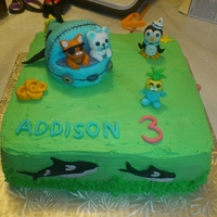 Octonauts Birthday Cake Buttercream iced with fondant creatures and fondant covered cake submarine.