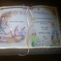 Peter Rabbit Baby Shower Carrot cake baked in large book pan covered in cream cheese frosting with images created by myself put onto edible paper.