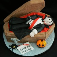 Dracula   Made for my friend's 50th bday. Coffin lid and Dracula are rkt/fondant, the rest is cake is covered in fondant.