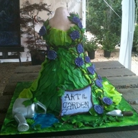 Art In The Garden  This cake was made for a garden gala. It was almost two feet tall. Upper body was rkt covered in fondant, the rest was vanilla cake with...