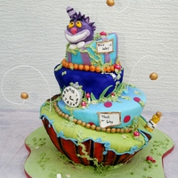 Alice In Wonderland / Madhatter Cake This was one of two Alice in Wonderland cakes I made for twins, along with a matching Dessert Table Vanilla sponge, all hand carved