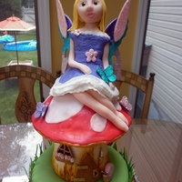 Enchanted Forest Fairy Cake I made this for a beautiful little girls birthday:) It was over 2' tall and all edible:)