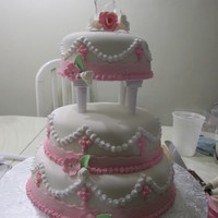 Pink Baptism fondant covered with pastiage flowers