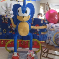 4' Sonic The Hedgehog Cake This is a 4' tall Sonic the Hedgehog cake made for my grandson.. The kids at the party were afraid of it until they realized it was...