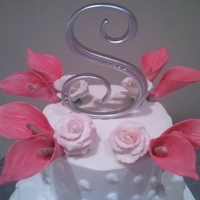 Gumpaste Calla And Rose   4 tier buttercream cake with handmade flowers.