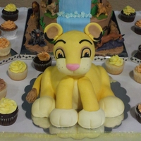 Simba Body is cake..head and legs are RKT. Made this cake along with the one behind it, they had toys for the tiered cake & made 150 cupcakes...