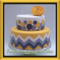 Chevron Print Wedding Cake With Sporadic Circles Covered In Fondant With A Gumpaste Flower Dusted In Luster Gold Luster Chevron print wedding cake with sporadic circles covered in fondant with a gumpaste flower dusted in luster gold luster