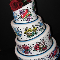 "1950's Tattoo Themed Wedding Cake All ""tatttoo's"" are hand painted"