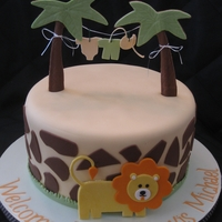 Baby Boy On Safari! Shower cake that was inspired by the nursery that has a safari theme. Lion was inspired by others I saw here and online...just had to wing...